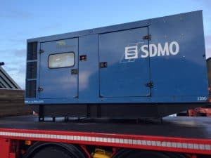 used diesel generator on hiab transport.